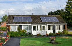 Solar Energy. Solar panels installed on domestic roof Royalty Free Stock Photo