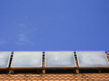 Solar energy. Equipment on the house roof Stock Photography