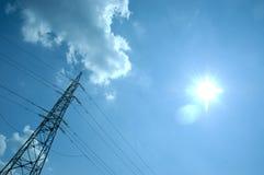 Solar energy. Voltage power pylon at blue sky and Sun, concept of solar energy Royalty Free Stock Photo