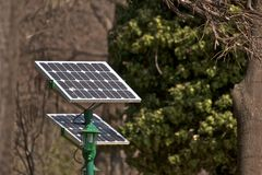 Solar energy. Small solar energy station in a park in Bucharest Romania Royalty Free Stock Images