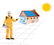 Solar energy. A construction worker with a house equipped with solar panels Stock Photography