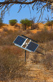Solar energy. Solar panel used for energy in semi-desert area Royalty Free Stock Images