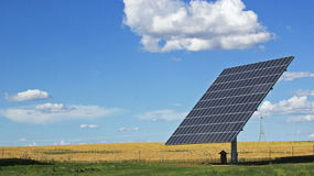 Solar energy. Solar renewable energy panel in blue sky Stock Photos