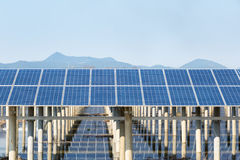 Solar energy against blue sky Stock Photos