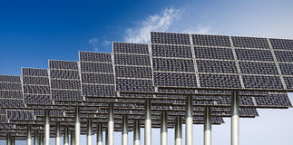 Solar energy background. Many solar energy panels against a blue sky Stock Image