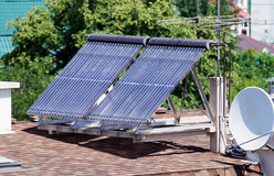 Solar energy collectors for heating the house Stock Photo