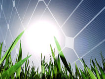 Solar energy concept. Fresh green grass field against the sun with solar panel Royalty Free Stock Images