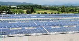Solar energy electric panels. Creation on a storage building Stock Photography