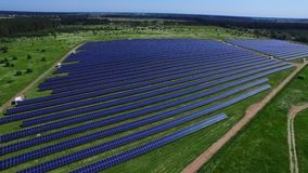 Solar energy farm producing renewable energy from sun. Solar panels aerial view. Green energy from renewable sources stock footage