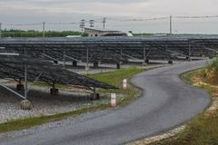 The solar energy fix type in Thailand with the bend road Stock Photography