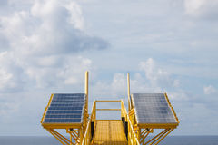 Solar energy is a green power, Solar cell for generate power for supply electrical equipment in offshore oil and gas platform.  Royalty Free Stock Image