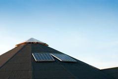 Solar energy panel. On top tar roofed farm building Royalty Free Stock Photos