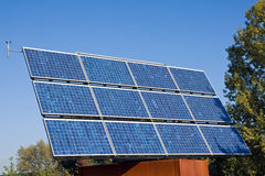 Solar energy panel and trees Stock Photography