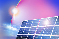 Solar energy panels. An image for the concept of Solar energy panels shown in a landscape with the sun, sky and clouds in the background Royalty Free Stock Photography