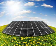 Solar energy panels. On dandelion field against sunny sky - fisheye shot Stock Photos