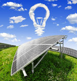 Solar energy panels. Bulb from clouds above the solar energy panels Stock Image