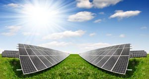Solar energy panels. Against blue sky with clouds Royalty Free Stock Photography
