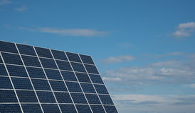 Solar energy panels against a blue sky stock image