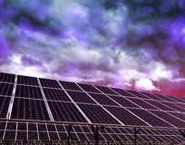 Solar energy panels against storm clouds Stock Photo