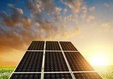 Solar energy panels against sunset sky Stock Images