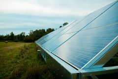 Solar energy panels in a farmer's field Stock Photography