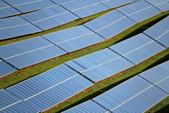 Solar energy panels on field. Solar energy panels arranged on undulating ground,  Photovoltaic solar power in Germany Stock Photo