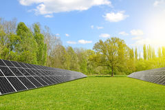 Solar energy panels. On meadow. Clean energy Stock Image