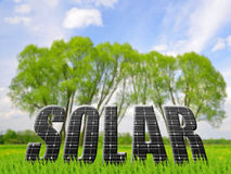 Solar energy panels on meadow. Royalty Free Stock Image