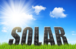 Solar energy panels on meadow. Concept of clean energy Stock Photography
