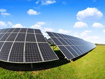 Solar energy panels on meadow. Royalty Free Stock Photography