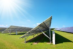 Solar energy panels on the meadow in sunny day. Stock Photo