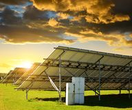 Solar energy panels in the meadow at sunset. stock photography