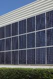 Solar energy panels mounted at wall. Photovoltaic solar energy panels, alternative electricity source, mounted at house wall Royalty Free Stock Photo