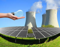 Solar energy panels with nuclear power plant Royalty Free Stock Photos