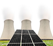 Solar energy panels before a nuclear power plant Royalty Free Stock Images
