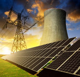 Solar energy panels, nuclear power plant and electricity pylon Royalty Free Stock Photography