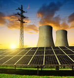 Solar energy panels, nuclear power plant and electricity pylon Royalty Free Stock Photo