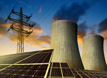 Solar energy panels, nuclear power plant and electricity pylon Royalty Free Stock Photos