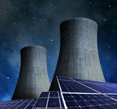 Solar energy panels and nuclear power plant Royalty Free Stock Images