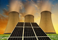 Solar energy panels before a nuclear power plant Stock Image
