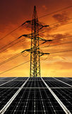 Solar energy panels with power line. In the sunset Royalty Free Stock Photography