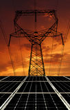 Solar energy panels with power line. In the sunset Royalty Free Stock Images