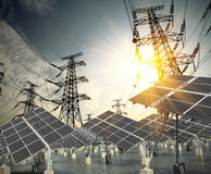 Solar energy panels and Power transmission tower Stock Images