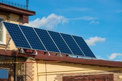 Solar energy panels on the roof of the house. aternative energy. Solar battery. Solar energy panels on the roof of the house. aternative energy. Solar battery stock images