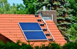 Solar energy panels on roof of house Stock Photography