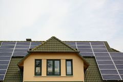 Solar energy panels on roof of house Royalty Free Stock Photography