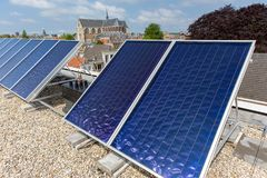 Solar energy with solar panels on the roof in Leiden. Collecting electricity with solar panels on a roof in the dutch city of Leiden royalty free stock photos