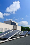 Solar energy panels on rooftop Stock Photos
