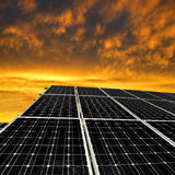 Solar energy panels. In the setting sun Royalty Free Stock Photography