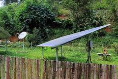 Renewable solar energy and telecommunications in a village of East Asia, in jungle royalty free stock photography